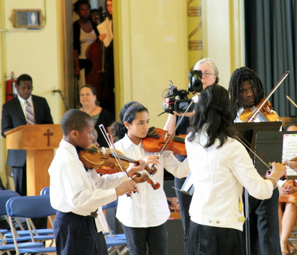 Play On, Philly! students performing last year at Saint Francis de Sales School.