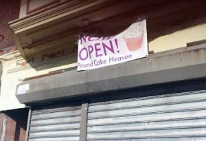 Pound Cake Heaven's Now Open sign at 5029 Baltimore Avenue (Photo by Annamarya Scaccia / West Philly Local)
