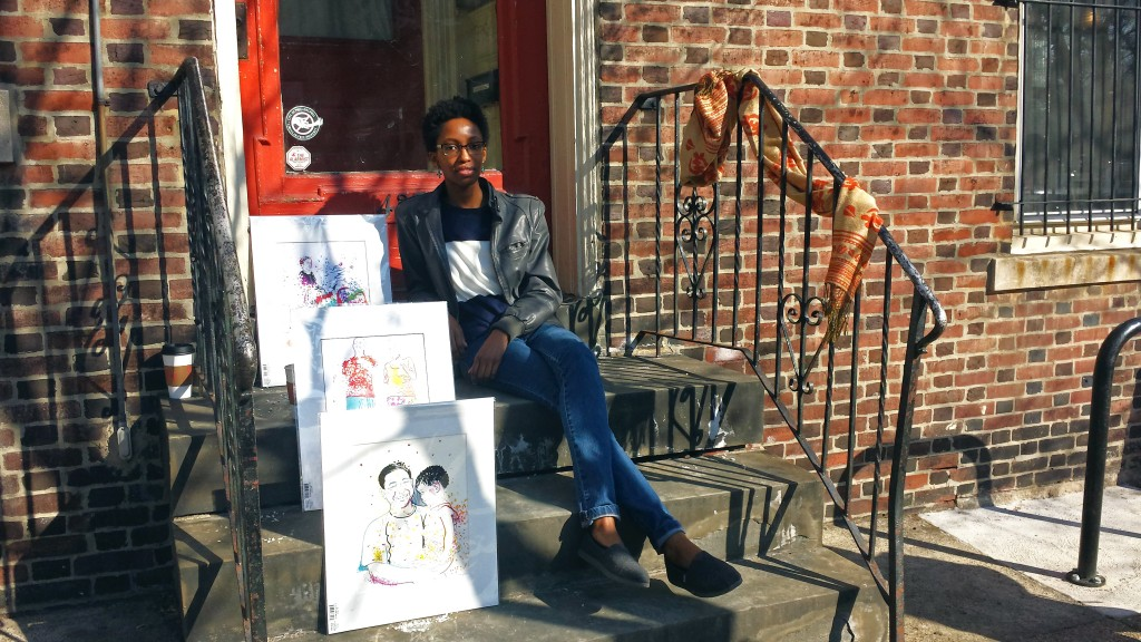 "West Philly artist Nile Livingston with some works from the ""Baltimore Avenue Series"" (Photo by Annamarya Scaccia / West Philly Local)"
