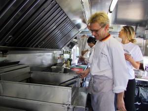 Chef Stirling Sowerby cooking on the line (Photo